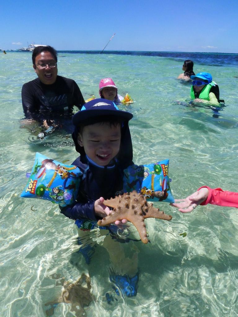 Discovering Starfish on Pandanon Sandbar